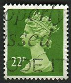 UK-CIRCA 1984: A stamp printed in UK shows image of Elizabeth II is the constitutional monarch of 16