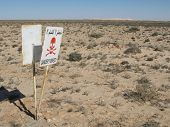 image of landmines  - Sign warning about the presence of lanmines near the Morocco - JPG