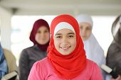 picture of muslimah  - Muslim and Arabic girls standing together in line row - JPG