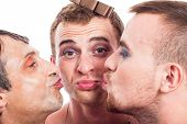 stock photo of transvestite  - Close up of three cute transvestites kissing isolated on white background - JPG