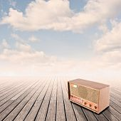 retro radio on pier with sky on sunset