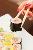 sushi with chopsticks