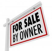The words For Sale By Owner on a home or house for sale sign put out by the homeowner who is also th