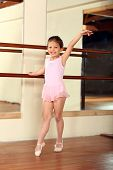 Cute little girl practicing her ballet
