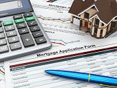 stock photo of currency  - Mortgage application form with a calculator and house - JPG