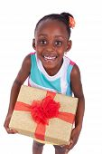 foto of biracial  - Young African American little girl holding a gift box isolated on white background - JPG