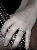 picture of klamath  - Hand with emerald wedding ring holding cello taken in Klamath Falls Oregon on August 12 2008 - JPG