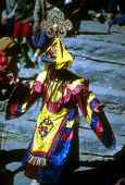 stock photo of tantric  - Mani Rimdu dancer dressed as Tibetan god for harvest festival Thyangboche Monastery Khumbu Himalaya Nepal Asia [[** Note: Shallow depth of field ** Note: Soft Focus at 100%, best at smaller sizes - JPG