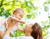 pic of infant  - Beautiful Mother And Baby outdoors - JPG