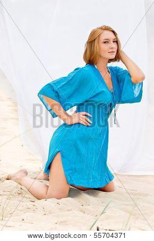 Girl In A Bathrobe At The Beach Wildlife