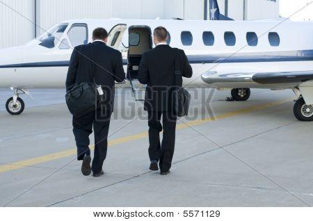Businessmen Walking Toward Corporate Jet