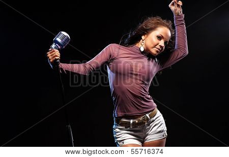 Woman Singer In Black Background