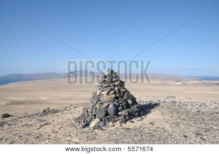 Stone Pyramid On Top Of A Mountain