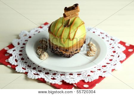 Homemade taffy apple, on napkin, on wooden  table background