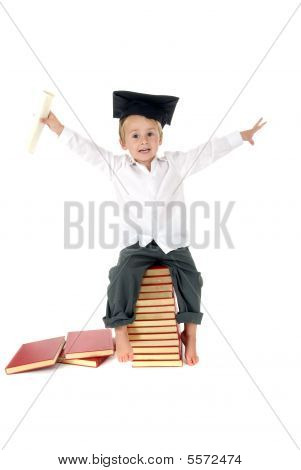 Cute Toddler With Graduation Cap And Diploma