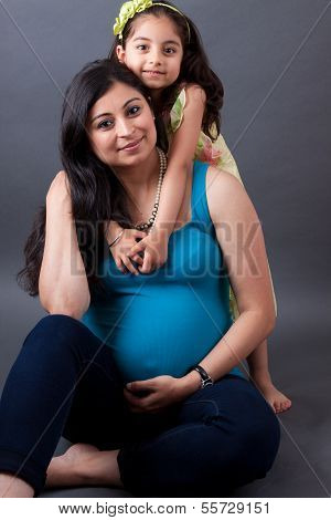 Pregnant East Indian Woman With Her Daughter