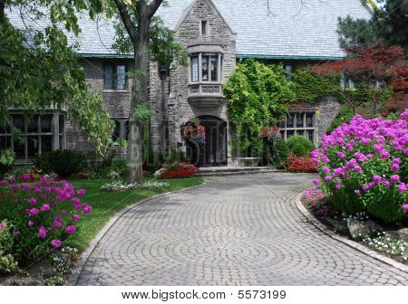 Large House With Circular Driveway And Hydrangea