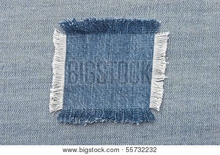 Closeup of blank jeans patch on inner side of worn blue denim