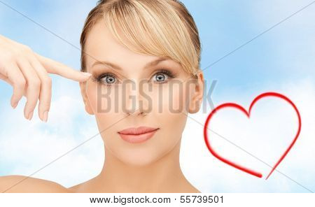 health, spa and beauty concept - beautiful woman touching her eye area