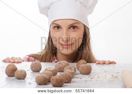 dough balls and woman chef cook