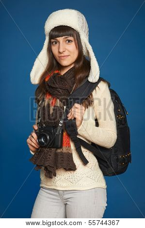 Winter woman with photocamera