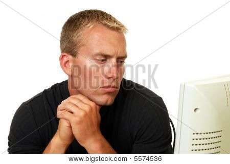 Concerned Man Looking At Computer