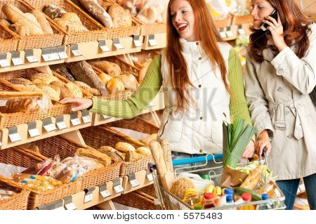 Grocery Store: Red Hair Woman And Brunette In Winter Outfit