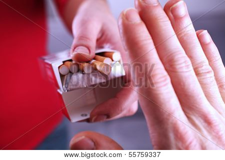Hand refusing cigarette