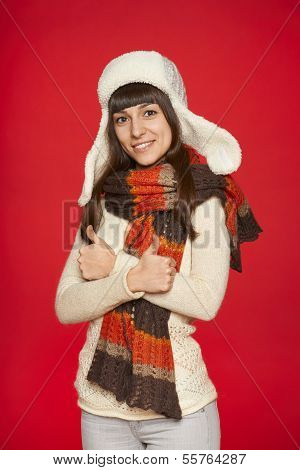 Winter girl showing thumbs up