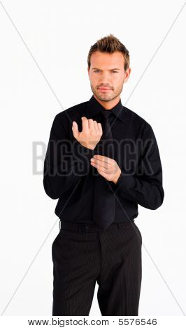 Young Businessman Corrects A Cuff Link