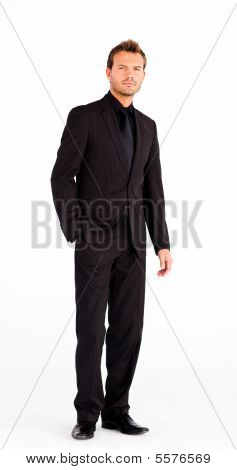 Handsome Businessman Standing In Front Of Camera