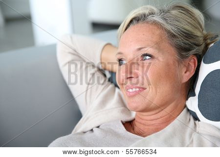Portrait of mature attractive woman relaxing at home