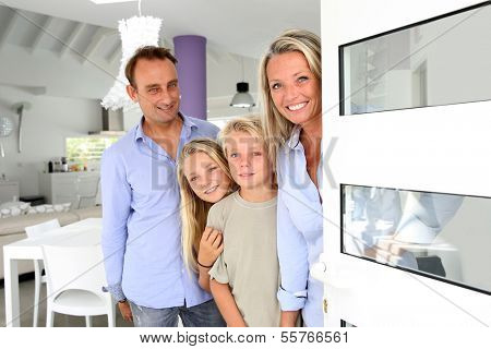 Happy family welcoming people at home