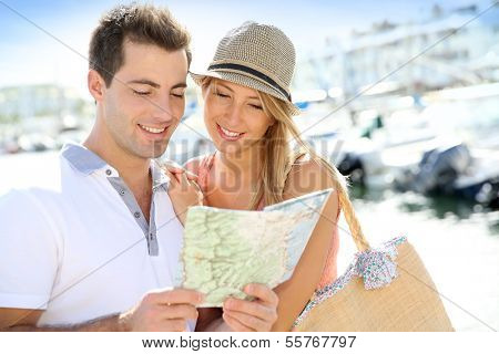 Couple of tourists looking at street map
