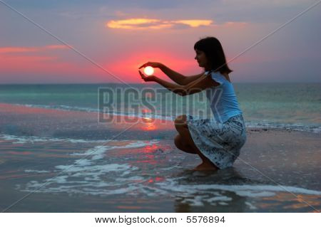 A Woman Early In The Morning On The Sea