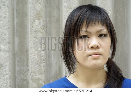 Serious looking teen lady in urban area