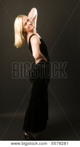Glamorous Woman Posing In Cocktail Dress