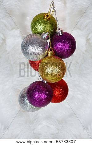 Colored Christmas balls on a white tinsel as a symbol of the New year