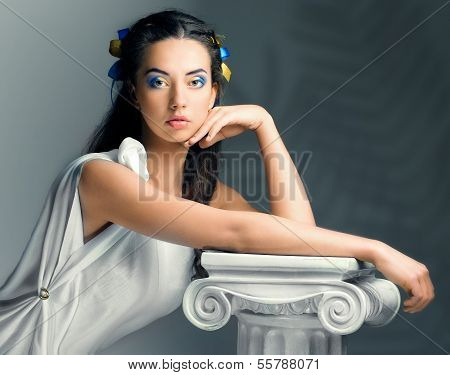 Beautiful Girl With Flowers In The Image Of An Ancient Goddess