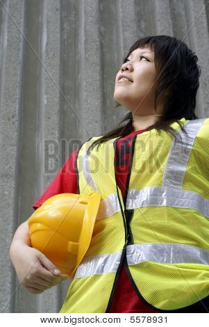 Asian female construction contractor lady looking up