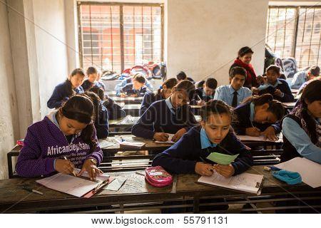 KATHMANDU, NEPAL - DEC 19: Unknown children in the lesson at public school, Dec 19, 2013 in Kathmandu, Nepal. Adult literacy (age 15+) 60.3% (female: 46.3%, male: 73%) in a 2010 population census.