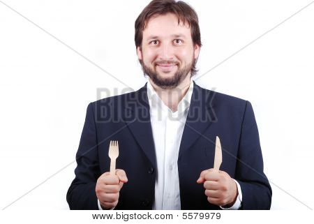 A Young Male Holding Fork And Spoon In Hands