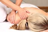 stock photo of skeletal  - Therapist iis doing professional massage in a praxis - JPG