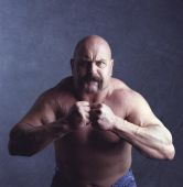 picture of shaved head  - image of strong man flexing muscles for portrait - JPG