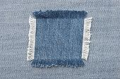 foto of denim jeans  - Closeup of blank jeans patch on inner side of worn blue denim - JPG
