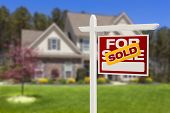 stock photo of borrower  - Sold Home For Sale Real Estate Sign in Front of Beautiful New House - JPG