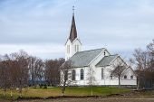 stock photo of west village  - Traditional white wooden Norwegian Lutheran Church in small village - JPG