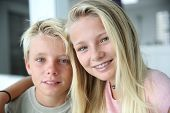 stock photo of braces  - Portrait of cheerful boy and girl - JPG