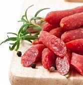 stock photo of peppercorns  - Smoked sausage with rosemary - JPG