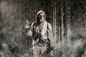 stock photo of chemical weapon  - Soldier wearing a gas mask is fighting in a forest - JPG